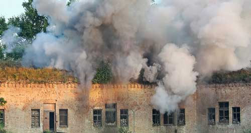 A building that is on fire after an explosion. Our lawyers in Westchester County negotiate with insurance company settlements for business explosions.