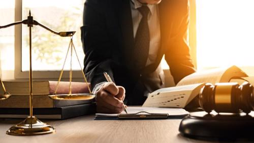 A personal injury defense attorney in New York reviewing paperwork for a case.
