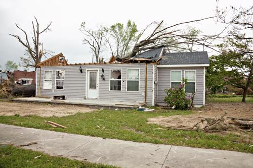 A residence with the roof removed form the home by a tornado.