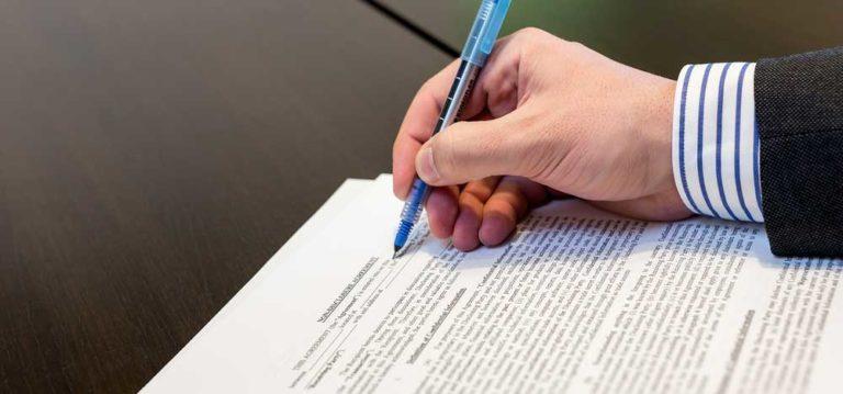 A man drafting an international contract.