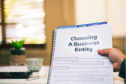 Business owner reading a document on different types of business formations